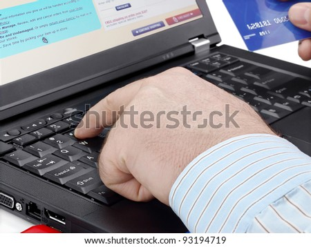 Businessman with credit card using computer for online purchase - stock photo