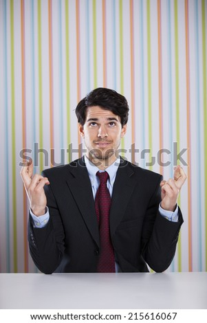 Businessman with cross fingers - stock photo
