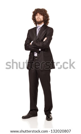 businessman with crossed arms,afro style hair and beard in a suit looking at camera isolated on white background - stock photo