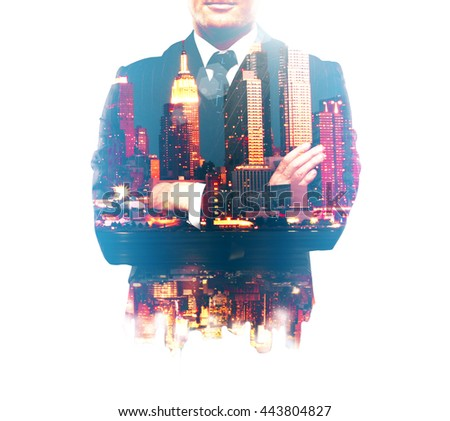 Businessman with crossed arms and night city isolated on white background. Double exposure - stock photo