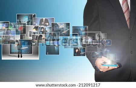 businessman with digital image on smartphone - stock photo