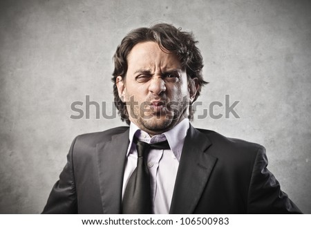 Businessman with disgusted expression - stock photo