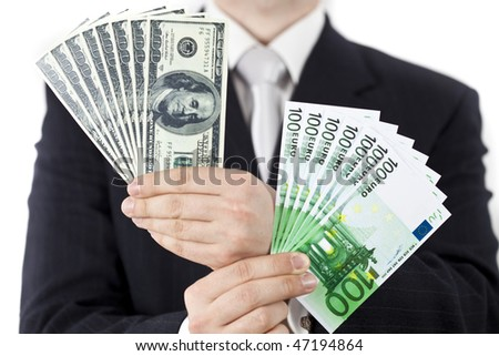 Businessman with euro and dollars isolated on white background - stock photo