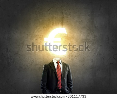 Businessman with  euro sign instead of head - stock photo