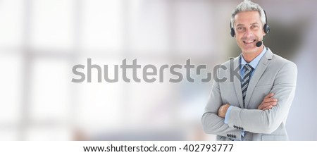 Businessman with executives using computers against sofa chair in the office - stock photo