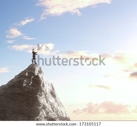 businessman with flag on top of mountain - stock photo