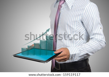 Businessman with growth chart of profits. - stock photo