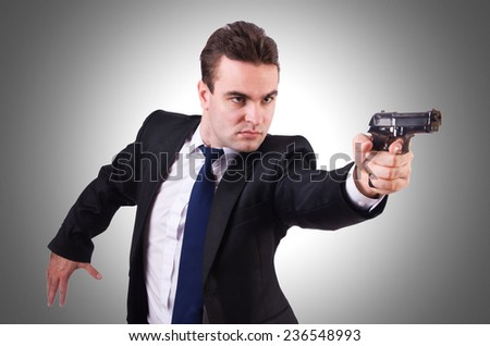 Businessman with gun isolated on white - stock photo