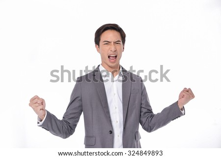 businessman with hand clenched as fist. victory, success, a winner in business. - stock photo