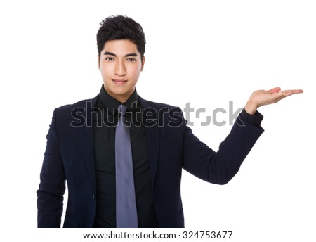 Businessman with hand showing blank sign - stock photo