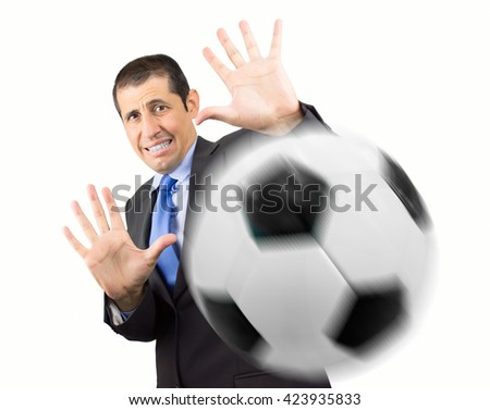 Businessman with hands in fear and goalkeeper playing football with white background - stock photo