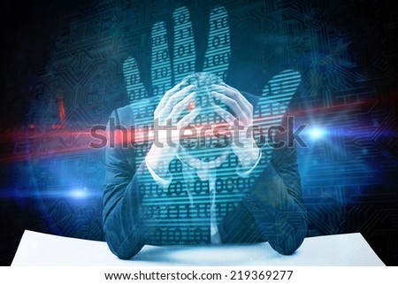 Businessman with head in hands against digital security hand print scan - stock photo