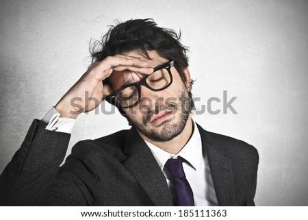 Businessman with headache - stock photo