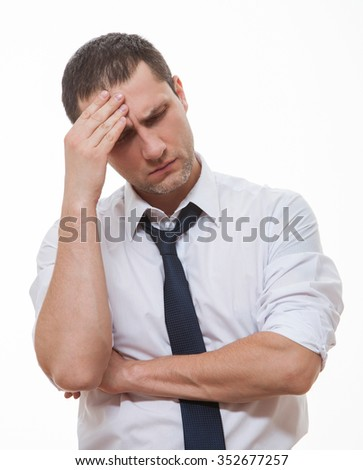 Businessman with headache, white background - stock photo