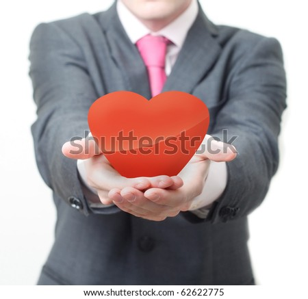 Businessman with heart - stock photo