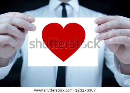 Businessman with heart icon - stock photo