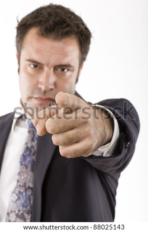 businessman with his arm extended and pointing - stock photo