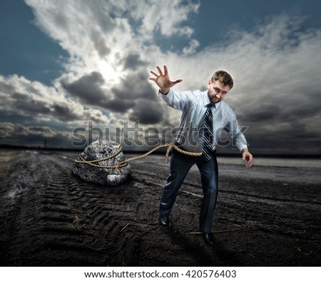Businessman with his burden - stock photo