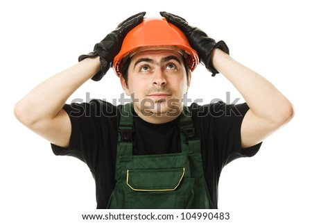 Businessman with his hands holding on to the helmet. - stock photo