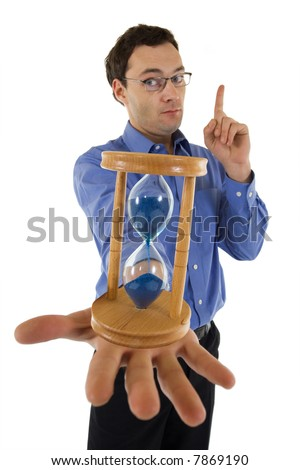 Businessman with hourglass aware of the approaching deadline - isolated - focus on hourglass - stock photo