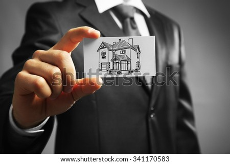 Businessman with house picture, concept real estate - stock photo