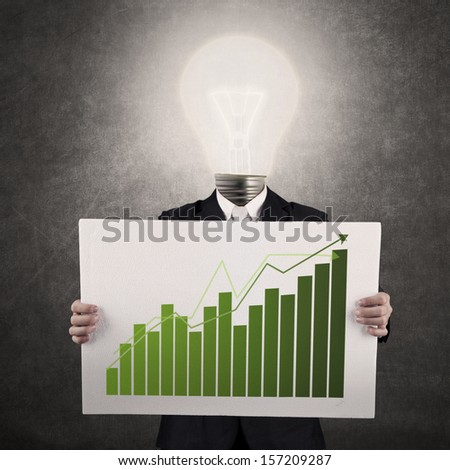 Businessman with lamp-head showing a graph on gray background - stock photo