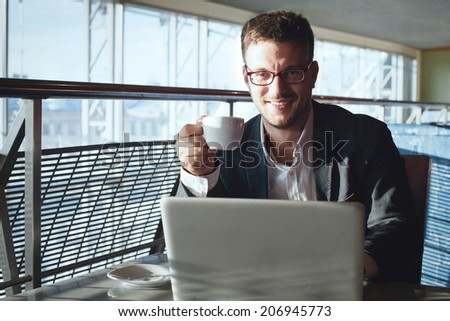 businessman with laptop in cafe - stock photo