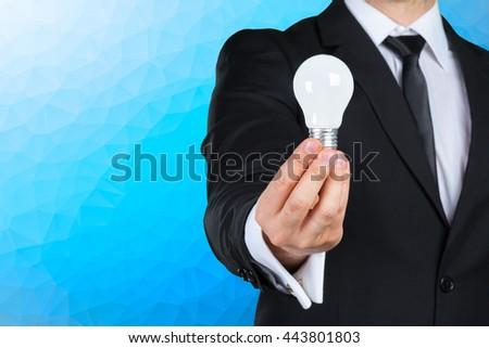Businessman with  light bulb concept for idea - stock photo