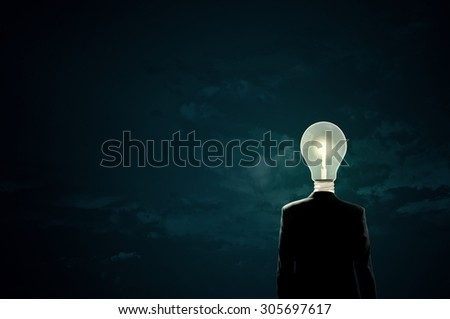 Businessman with light bulb instead of head - stock photo