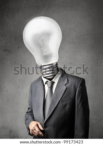 Businessman with light bulb instead of his head - stock photo