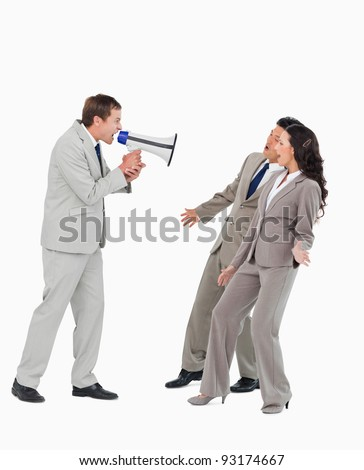 Businessman with megaphone yelling at associates against a white background - stock photo
