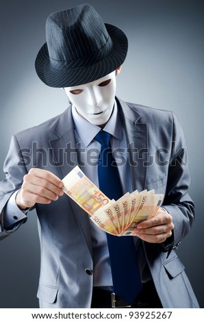 Businessman with money and mask - stock photo