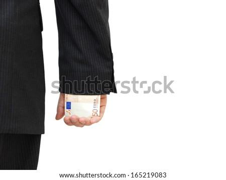 Businessman with money hidden under sleeve - stock photo