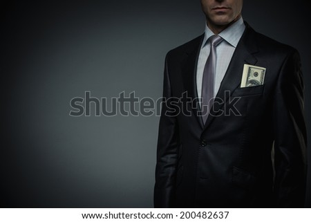 Businessman with money in studio - stock photo