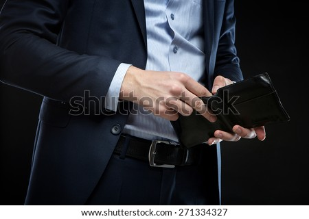 Businessman with money in studio - stock photo