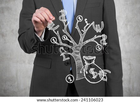 businessman with money tree on a gray background - stock photo