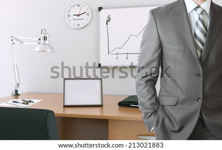 Businessman with office working place - stock photo