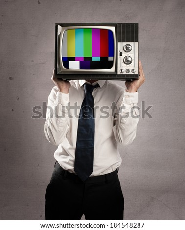 businessman with old retro television on his head - stock photo