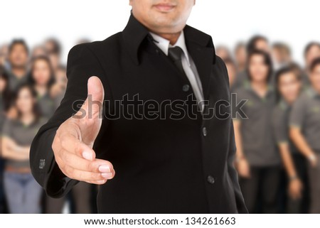 Businessman with  open hand ready to seal a deal - stock photo