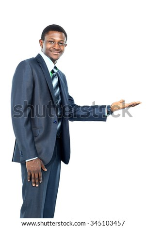 Businessman with open palm offering something - stock photo
