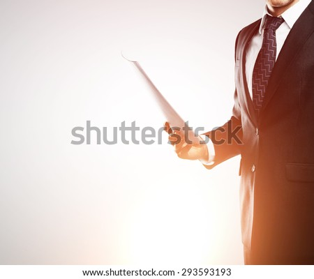 businessman with paper on white background - stock photo