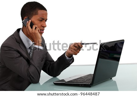 Businessman with phone and laptop - stock photo