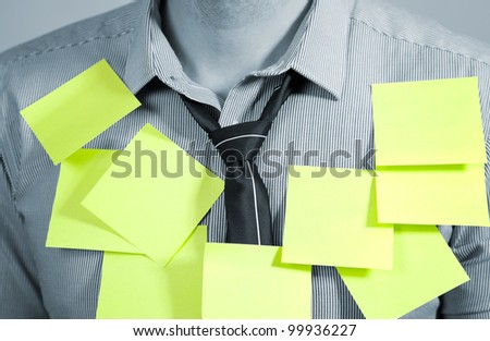 Businessman with plenty of post it notes - stock photo