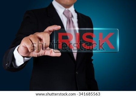Businessman with risk text label. - stock photo