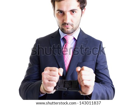 Businessman with shackles on his hands, isolated on white. Conceptual image. - stock photo