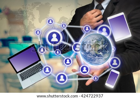 Businessman with show hand posture with the Social media and technology device on computer room background, Elements of this image furnished by NASA, Business network concept - stock photo