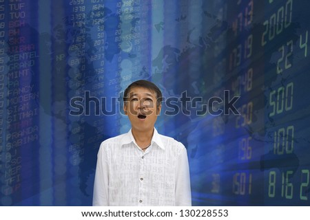 Businessman with stock exchange graphics on the background - stock photo