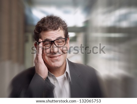 Businessman with stress headache pain holding head - stock photo