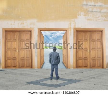 Businessman with success door - stock photo