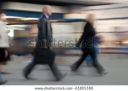 Businessman  with suitcase rushing to work at the morning in intentional motion blur. - stock photo